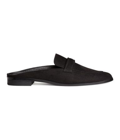 Black. Backless loafers in faux suede. Faux leather lining, faux leather insoles, and rubber soles. Heel height 3/4 in.