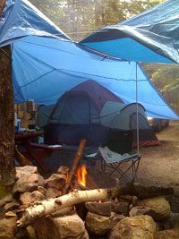 Tarps provide additional family camping shelter