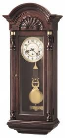 Howard Miller Key-wound Pendulum wall clocks mahogany finish 612221-This unique Howard miller wall clock has an individually carved, scalloped shell on the pediment is designed similar to a John Goddard original.