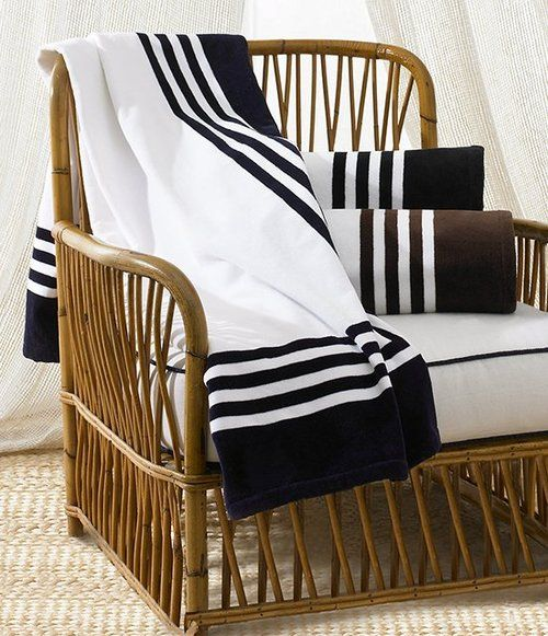 Art Deco Towel by Ralph Lauren looks great hanging over this classic rattan chair! pinned by wickerparadise.com