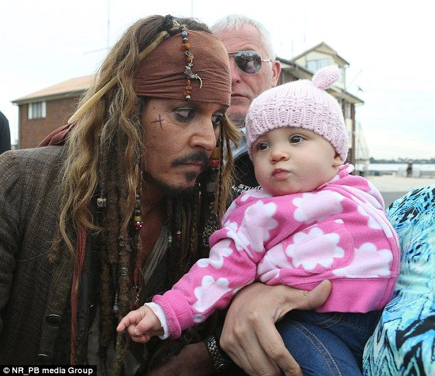"Johnny Depp meets a young fan while filming ""Pirates of the Caribbean: Dead Men Tell No Tales"" in Australia."