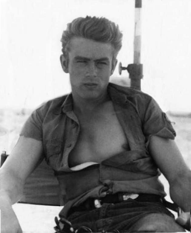 James Dean the Giant sitting in a chair on location in Giant