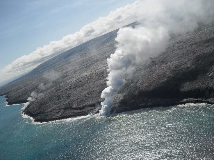 Hilo, Hawaii ( lava is moving into the ocean, from helicopter view)