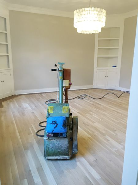 What to expect when you're getting your floor refinished. Cost, timeline, and tons of after pics!