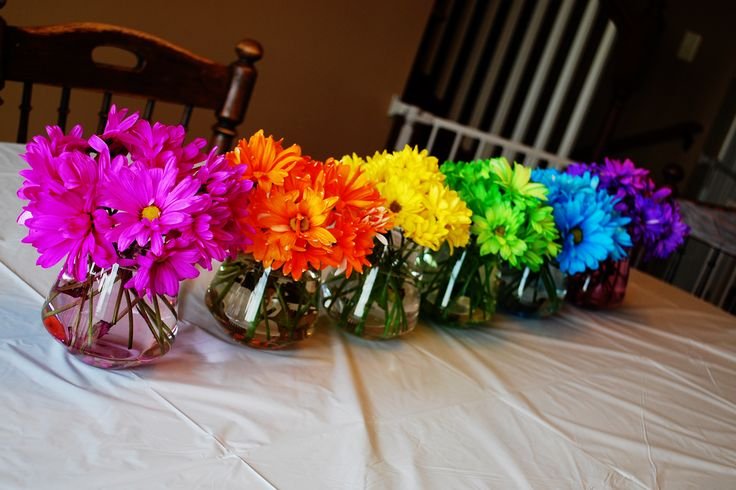 #Rainbow party:  flowers.  Somebody needs to fix this tablecloth.  But the flowers are pretty darn festive!
