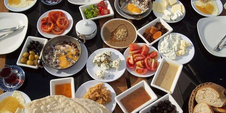 """Feast at Breakfast in """"TURKEY: A traditional breakfast consists of bread, cheese, butter, olives, eggs, tomatoes, cucumbers, jam, honey, and kaymak. It can also include sucuk, a spicy Turkish sausage, and Turkish tea."""""""