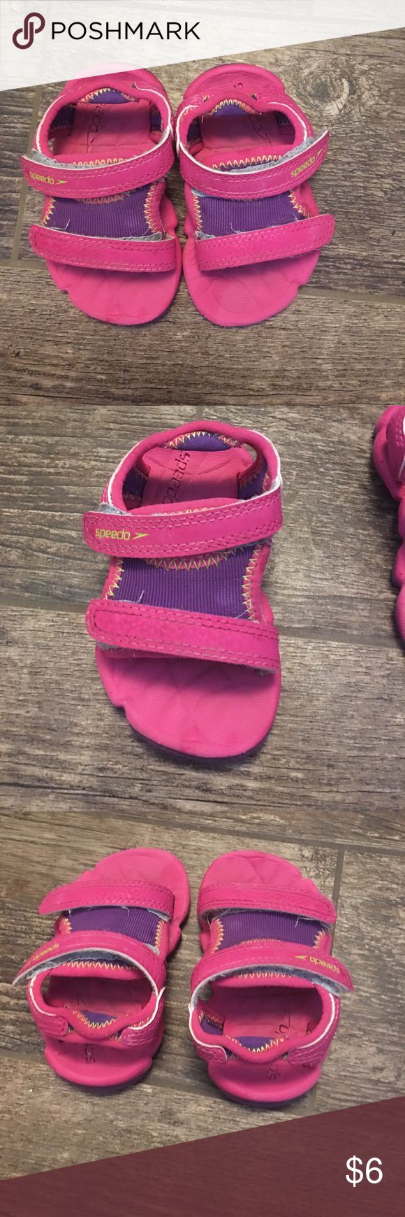 Water shoes for baby Used but in good condition. My daughter wasn't able to walk yet in these so the bottoms are perfect. Velcro at ankle and toes. These strangely don't say a size anywhere that I can find but I'm going to guess between 3-5 Speedo Shoes Water Shoes