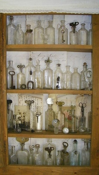 Great way to display old keys and bottles.  My dad had a ton of these....hmmm what to do with them