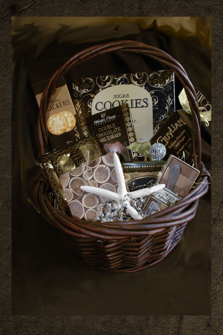 "Add some sparkle this Christmas with a Black-and-Gold basket of fun coasters, Starfish, a mini spreader and sweet delights.   CB004    $59.99  ""Add a bottle of wine and glasses at an extra charge"""