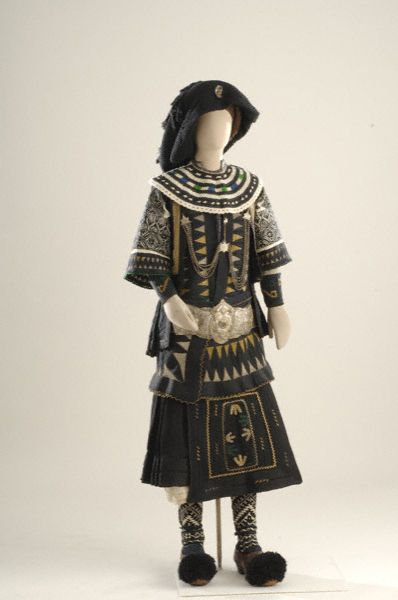 Bridal costume worn by the Sarakatsani of Thrace. Its main components are the tsourapia, the tsarouhia, the pleated fousta (skirt) that fastens to the panaoula, a sleeveless buttoned waistcoat, an apron whose decoration was associated with apotropaic powers and fertility worship, and the foki (belt with buckle). The boho, an especially hand-loomed kerchief worn on the head. [http://www.europeana.eu/portal/record/08540/_popup_php_photo_id_2577_lang_gr.html]