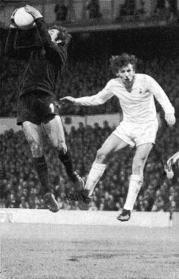 7th March 1973. Tottenham Hotspur captain Martin Peters challenging Victoria Setubal goalkeeper Joaquim Torres in the UEFA Cup 4th round 1st leg, at White Hart Lane.