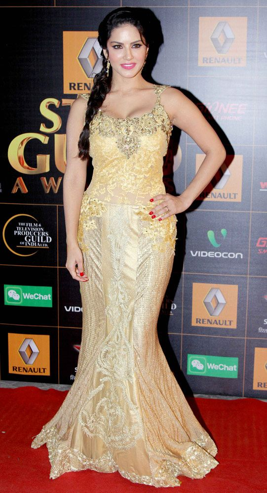 Sunny Leone titillates in a golden floor-length gown at the Star Guild Awards 2014. #Style #Bollywood #Fashion #Beauty