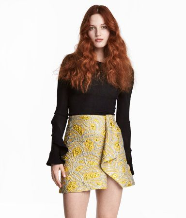 Yellow/patterned. CONSCIOUS EXCLUSIVE. Short skirt in jacquard-weave fabric made from recycled polyester along with mulberry silk, glittery threads, and