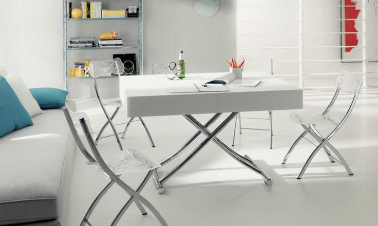 MAGNUM, design: studio Ozeta - Metal frame transformable table, gas adjustable height from cm 25 to cm 76, extendable telescopic mechanism, glass top and frame , with three 55 cm outside extensions and one inner inside extension of cm 45. www.ozzio.com
