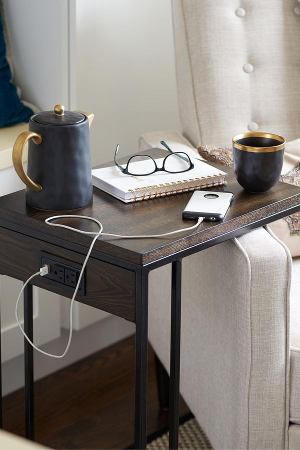 In a small space, the compact C table provides the perfect all-purpose surface as it neatly tucks over and into the armchair. The newest style comes with built in charging capabilities.