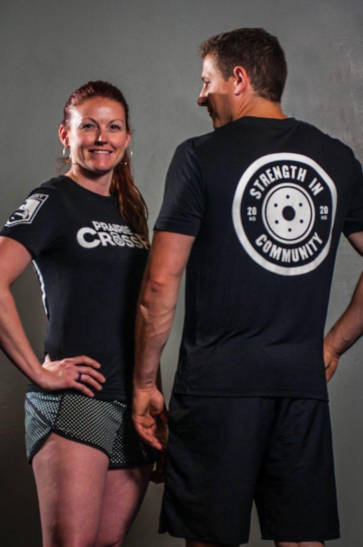 Derek and Mandy owners of Prairie CrossFit in their custom WOD shirts .