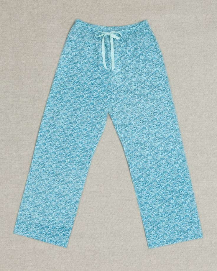 Moonbird classic long pants have an elastic waistband and cotton drawstring for an adjustable fit. Our comfortable loose pants are made from beautifully soft 100% GOTS certified woven organic cotton and are hand screen printed with Sea Leaf print. Pants have french seams and cotton care labels for extra comfort. Cotton brand label can also be used as a hanging loop. Dyed, printed and assembled in Jaipur, India in a Fair Trade accredited facility. $65 AUD