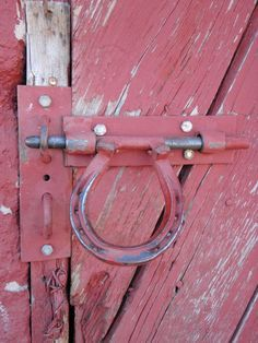 Horseshoe handle on barn door.