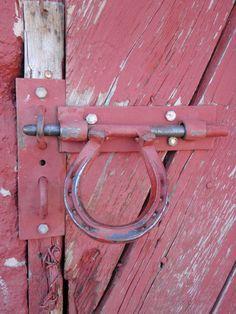 Horseshoe handle on barn door.