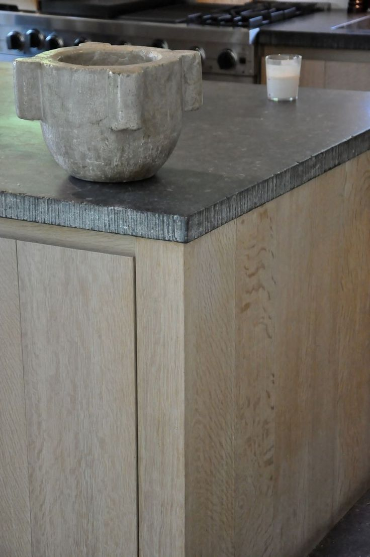 detail of a stone kitchen in Belgian home  Like cabinet wood and glaze/finish with gray counter tops  MPS