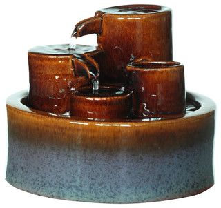 An indoor/outdoor water fountain is a great way to add a peaceful accent to your decor. This modern design features three tiers of Ceramic Fountain. Water