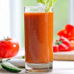 Tomato-Vegetable Juice Recipe  1 cup chopped hearts of romaine 1/4 cup chopped fresh chives 2 large tomatoes, cut into wedges 1/4 fresh jalapeño , stemmed and seeded 1 large red bell pepper, cut into eighths 2 large stalks celery, trimmed 1 medium carrot, peeled Ice cubes (optional)
