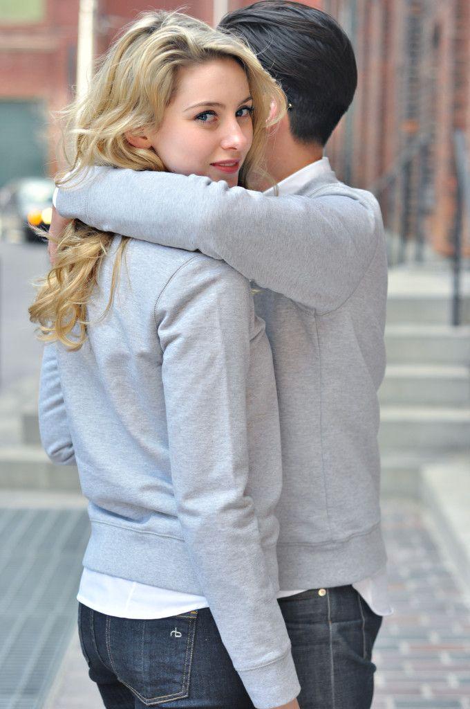 Elizabeth Victoria Clark and her boyfriend John model matching handvaerk unisex sweatshirts.