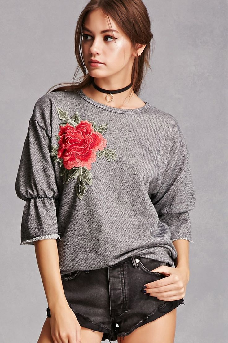 A heathered, French terry knit top featuring a  floral chest applique, round neckline, dropped shoulders, 3/4 sleeves with elasticized cuffs and raw-cut trim, and a relaxed fit.<p>- This is an independent brand and not a Forever 21 branded item.</p>