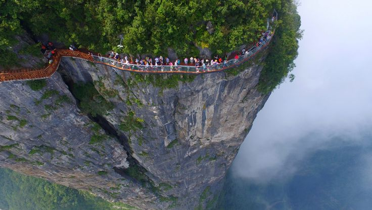 https://qz.com/749920/a-terrifying-aerial-photo-of-thrill-seekers-testing-chinas-newest-cliffside-glass-walkway/
