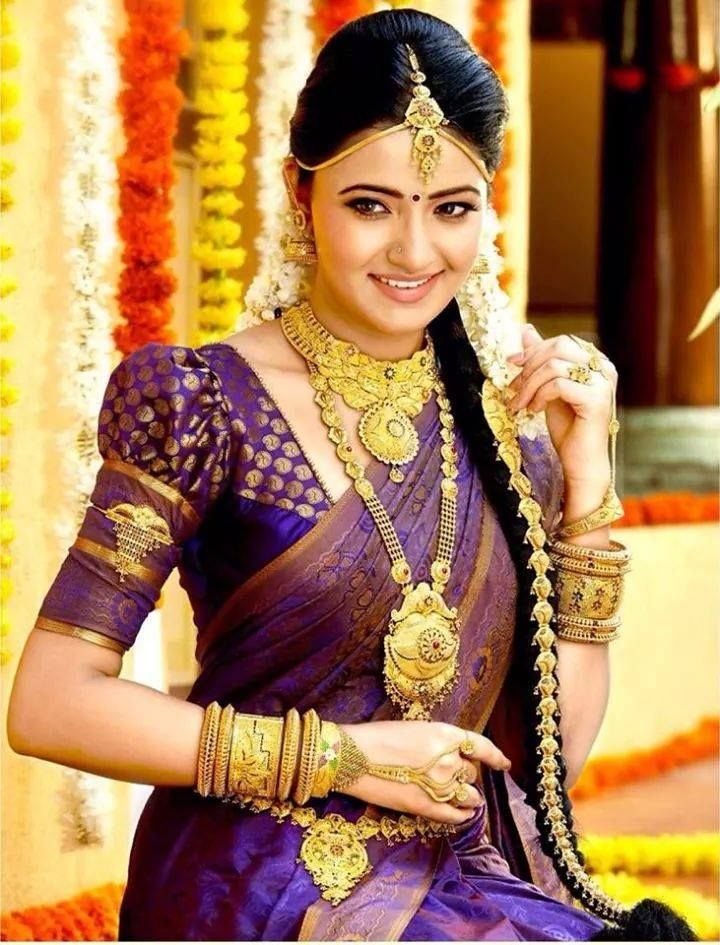 South Indian bride. Temple jewelry. Jhumkis.Purple silk kanchipuram sari.Braid with fresh flowers. Tamil bride. Telugu bride. Kannada bride. Hindu bride. Malayalee bride.Kerala bride.