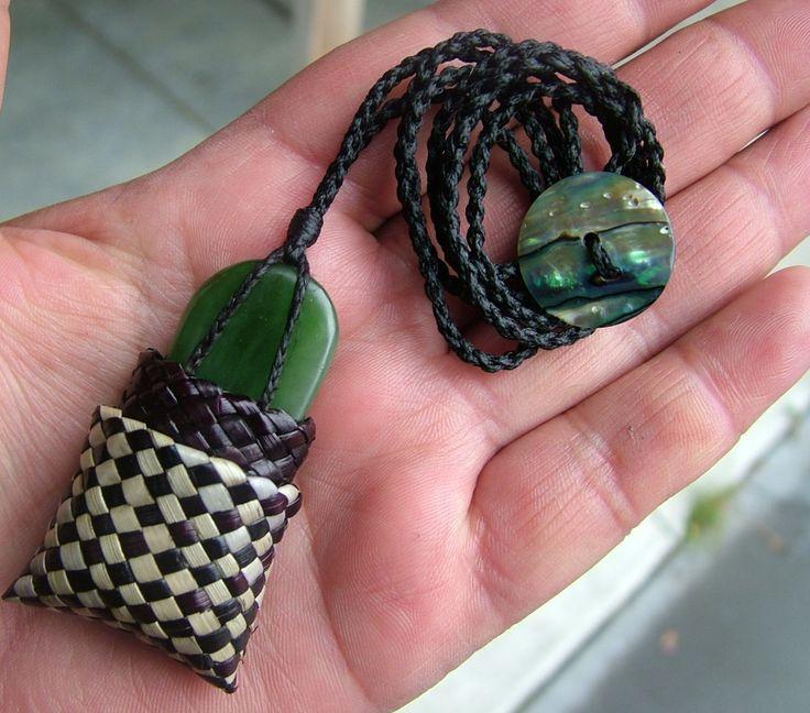 Pounamu (greenstone) necklace Kete (basket) Harakeke (flax).
