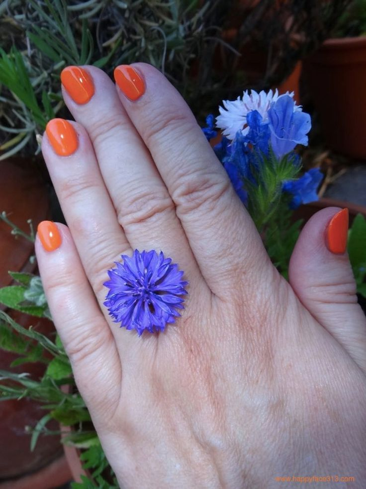 :-) contrasting blue flower and orange just cosmetics colorazzi nail polish in 110 be crazy :-)