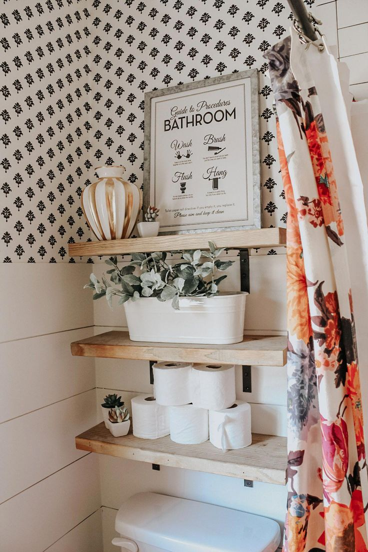 Chic bathroom with open wood shelving above toilet that can be used as storage a…   – bathroom wallpaper