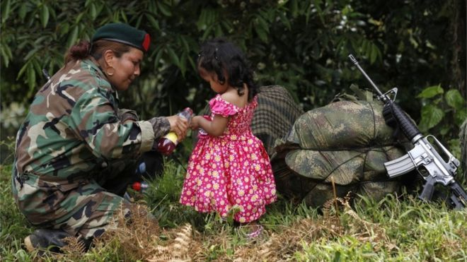 Colombian Farc rebels on 'final march' 1 February 2017  From the section Latin America & Caribbean Share Two months after a peace deal in Colombia, Farc rebels gather for final demobilisation. A Farc rebel pours juice for a local girl as she arrives at a transition zone in Cauca province in Colombia on 31 January 2017