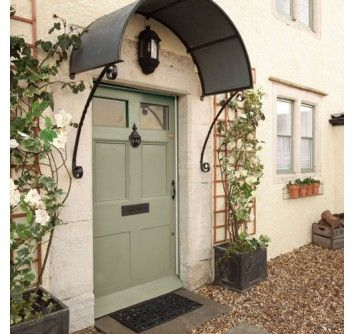 Dulux Trade Weathershield: Exterior Gloss Highland Green. Gorgeous light green door with trellis and flower - cute for country homes