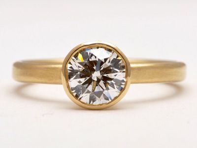 The ONLY engagement and wedding rings I have ever liked are made by New York Wedding Ring. This one is pretty near perfect. :]