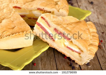Pizza rustica, traditionally Italian savory pie filled with cheese and salami, made in Naples for Easter.