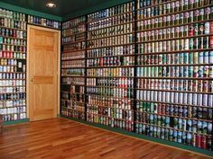 This would be a cool idea for a man cave! This guy decorated his entire house with his beer can collection!