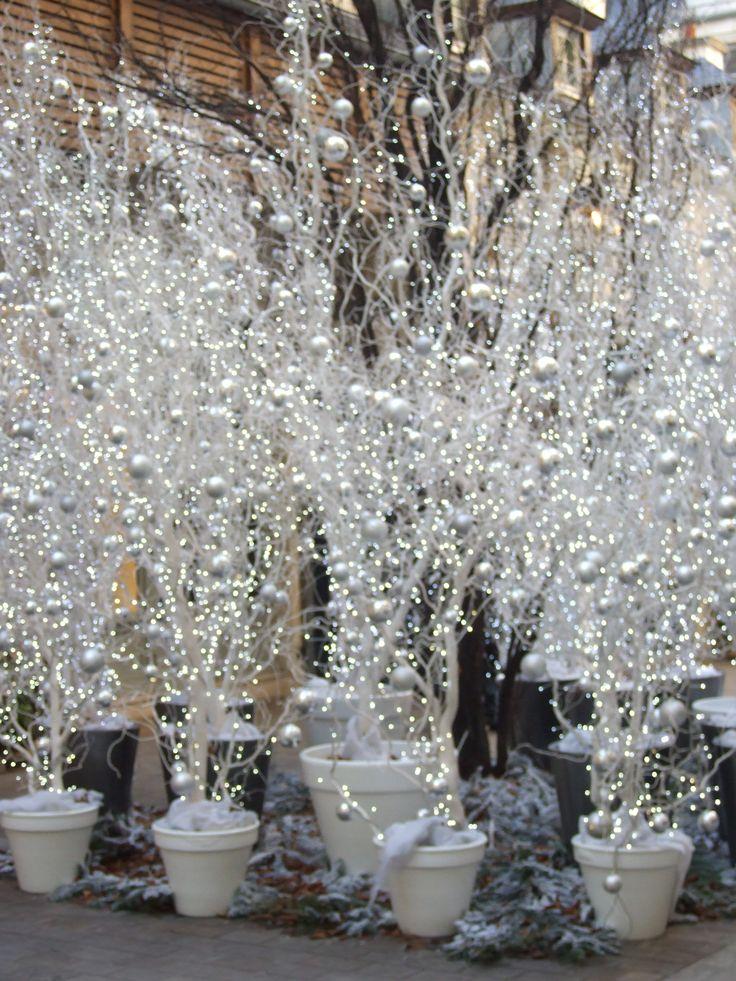 curly willow, lights, white balls, white snow flakes, glittery white decorations, white terra cotta pots