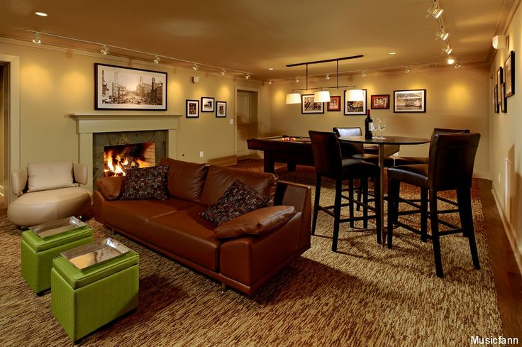 This large basement has an area for lounging, a pool table and even a small dining area. Check out the fireplace along the back wall! Click to see how much it costs to remodel a basement.