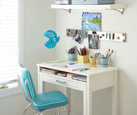 I love how the magnetic bar and kids desk storage containers in this photo are used to keep the work area neat and tidy. For more storage for kids ideas visit http://storageforkids.net