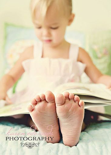 Cute idea of focusing on little ones feet whilst they are sat reading. I would also do a 'reverse' photo - where the child is in focus and the feet are out of focus