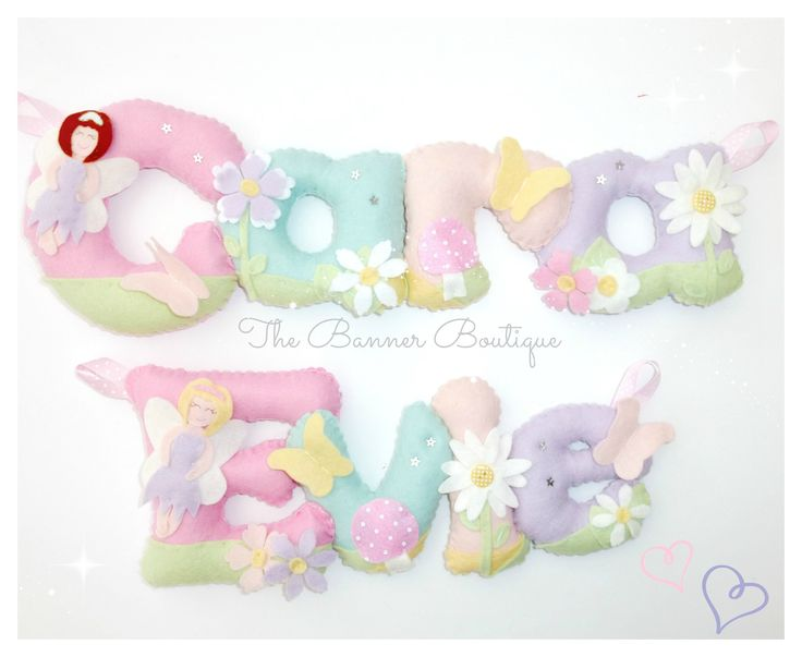 Fairy themed personalised felt name banners in pastel colours.