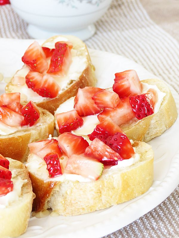 Strawberry Honey Bruschetta.... Bruschetta with cream cheese, strawberries and honey. They are totally delicious. They can be prepared early which is a win-win situation when you want to make something early for the party.