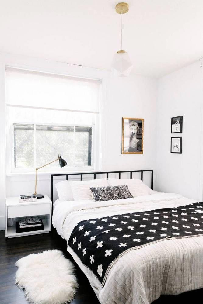 Small Monochrome Bedroom With A Black Metal Bed Frame Simple