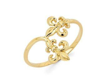 gold fleur de lis ring.