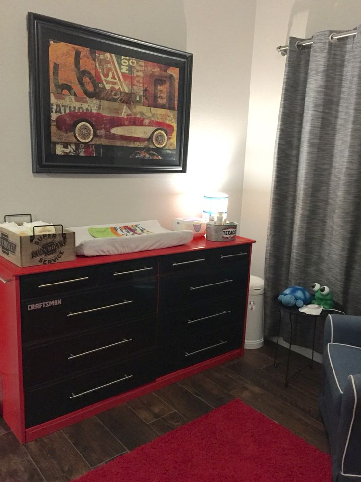 Hot rod, vintage car nursery. Craftsman tool box changing table / dresser. Picture, wooden diaper box, Texaco metal container- Hobby Lobby. Dresser- painted by my husband! Craftsmen decal- eBay