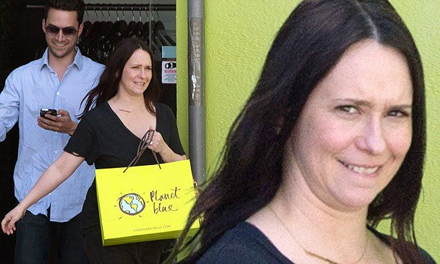 The 38-year-old pinup went makeup free to Planet Blue with husband of four years, Brian Hallisay. She looked happy as she exited the store with her spouse.