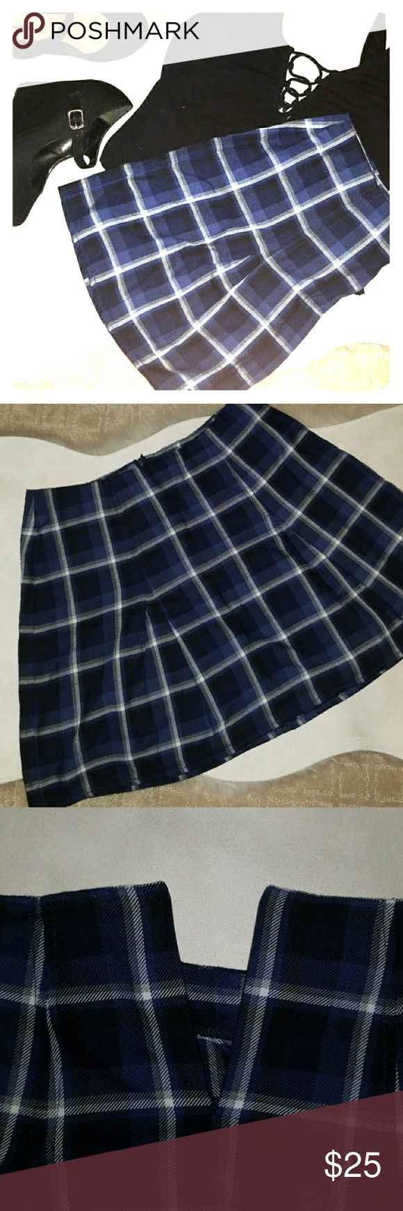 Plaid Mini Skirt Blue, black, white and grey plaid skirt. Pleats wrap around the dress to give some extra movement. Made to rest at the waist line. Bought at Aeropostale from the line Bethany Mota Aeropostale Skirts Mini