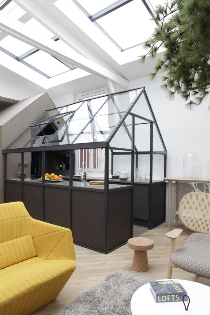 """A MELLOW YELLOW """"GREENHOUSE"""" IN PARIS Designer Grégoire de Lafforest takes inspiration for a modern French kitchen from outdoor greenhouses...."""